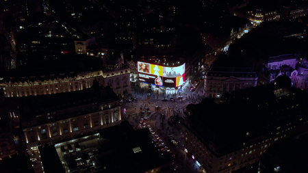 London, UK - October 2018: Aerial view at night of the Piccadilly Circus square international tourist destination feat. Piccadilly Lights, one of the UK's most iconic landmarks in London, England UK