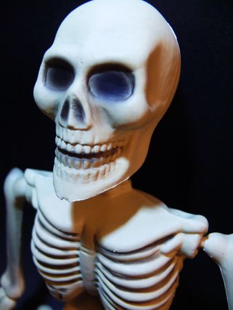 Smiling skeleton, from waist up.