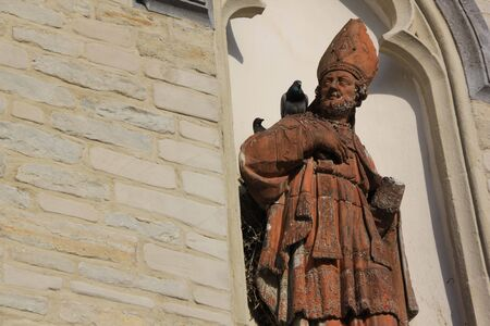 priest talking to messenger (bird)