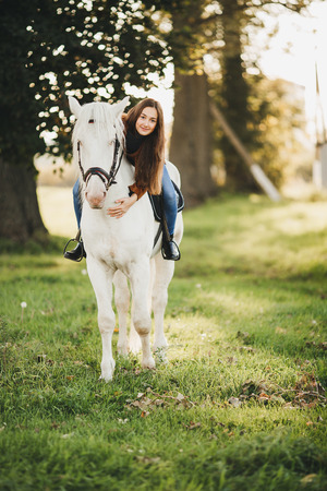 Beautiful girl with horse and long hair photo