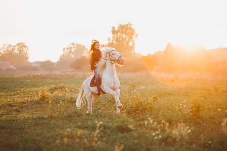 meadows: Beautiful girl with horse and long hair Stock Photo