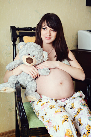 beautiful pregnant girl with dark hair photo shoot on the street photo