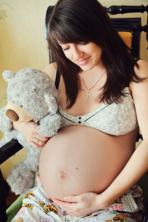 beautiful pregnant girl with dark hair photo shoot on the street