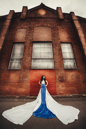 beautiful long-haired brunette in blue-white dress angel photo