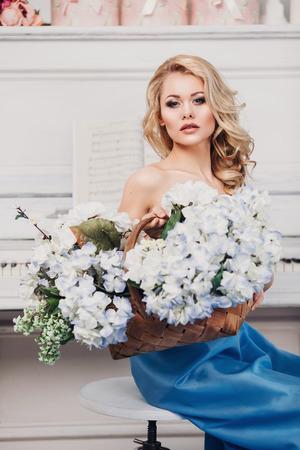 beautiful girl in a long blue dress beautiful girl in a long blue dress photo