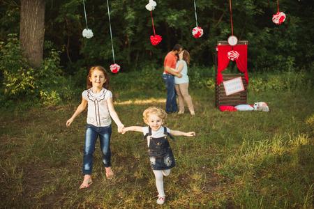 Happy smiling family on nature photoshoot Happy smiling family on nature photoshoot photo