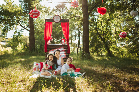 moon chair: Happy smiling family on nature photoshoot Happy smiling family on nature photoshoot