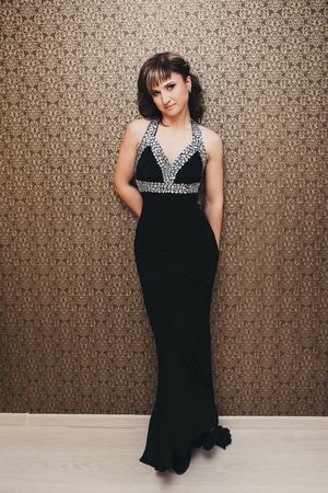 beautiful girl in elegant black dress beautiful girl in elegant black dress photo