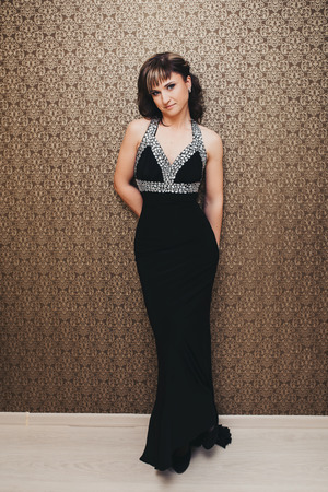 beautiful girl in elegant black dress beautiful girl in elegant black dress photo