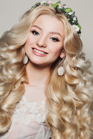 portrait of a beautiful young blonde woman with long curly hair photo