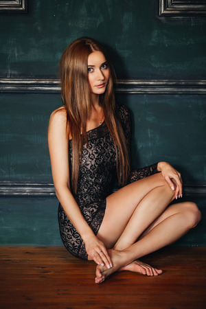 naked youth: beautiful slim sexy girl with long hair in a short black dress