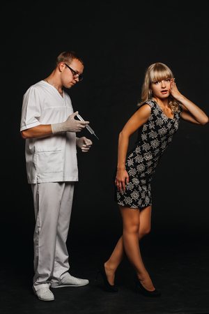 doctor in a white coat is going to make a shot in the ass girl patient doctor