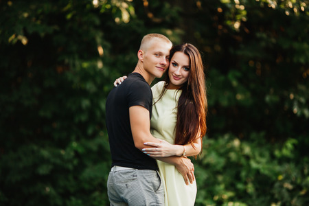 parejas romanticas: beautiful young couple in love outdoors, trees, blurred
