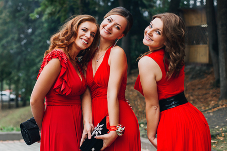 bridesmaid: beautiful girl bridesmaid in red dress posing Stock Photo