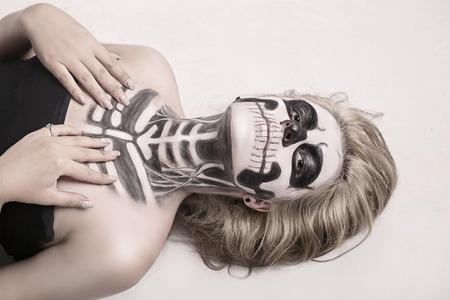 dead girl: girl on the face of the skeleton Halloween