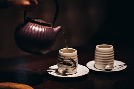 sparce: Image of traditional eastern teapot and teacups on wooden desk