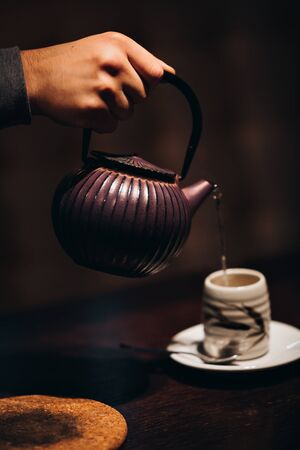 teacups: Image of traditional eastern teapot and teacups on wooden desk
