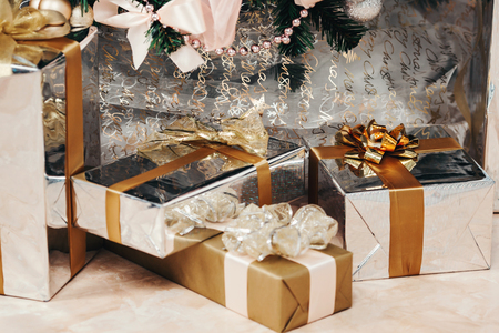 frippery: elegant Christmas tree decorated. a lot of different gifts under the tree, a beautiful gift box, festive feeling, Christmas concept