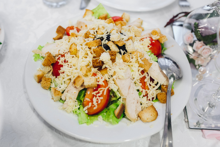 chicken caesar salad: Chicken Caesar Salad. Salad with chicken and vegetables, sprinkled with grated cheese