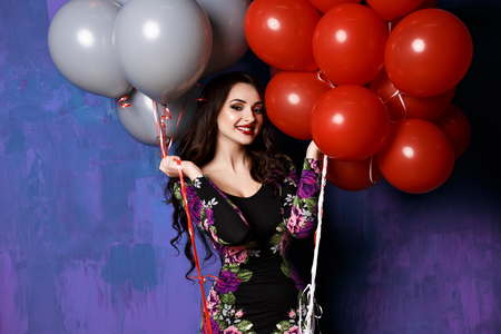 party people: Beautiful woman with balloons. Happy young woman with big colorful latex balloons. Outdoors, lifestyle.