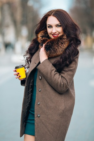 silver fox: Beautiful Woman in Luxury Fur Coat. Stylish brunette woman in brown coat. young sexy sensual seductive woman with perfect fluffy curled hairs,amazing smile with brilliant white teet, vintage sunglasses..