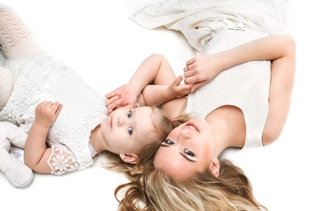 mum and daughter: Family portrait. Mother hugging daughter. White background isolated.