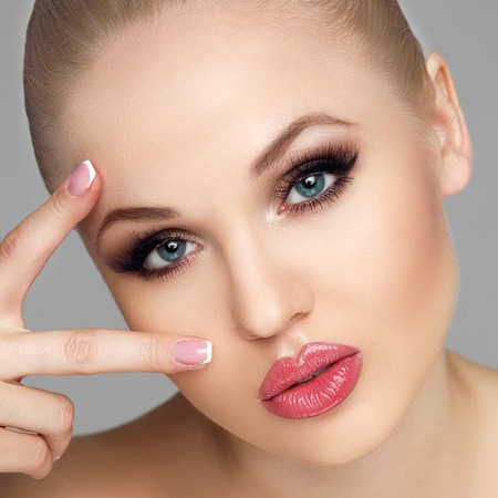 naildesign: Portrait of glamorous and elegant women, close-up portrait, hold the fingers near the eyes, French manicure, gentle clean skin, big eyes, luxury makeup, beauty salon