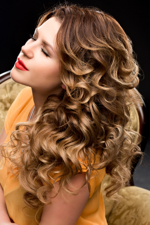 hair highlights: Portrait of beautiful girl with long hair. The concept of beautiful hair, wavy hair, highlights, beautiful hair color. Dark brown, blonde