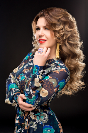voluminous: Portrait of beautiful woman with magnificent curly hair, trendy jewelry,stylish clothing. Jewelry: ring, earrings. Jewelry Stock Photo