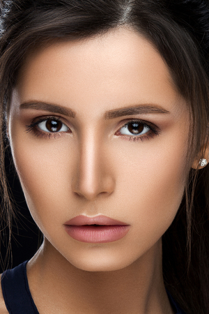 Gorgeous woman with perfect skin and makeup after beauty salon.