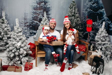 Happy family with kids at Christmas time.