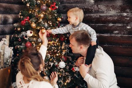 Father and kid decorating Christmas tree.Christmas decoration. 版權商用圖片