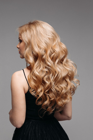 Stunning woman with perfect wavy blonde hair. Banco de Imagens