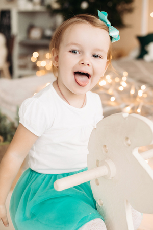 Adorable little girl with bow on head posing.