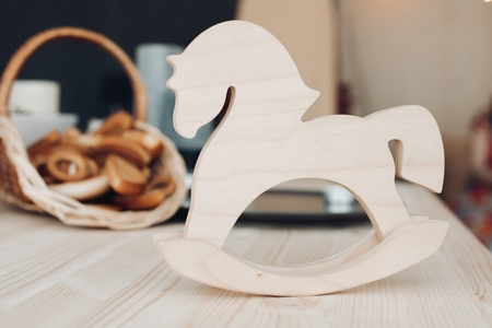 White wooden rocking horse. Children toy toy Фото со стока