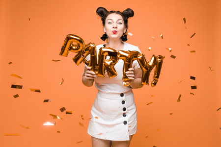 portrait of beautiful woman celebrating a party and having fun Imagens