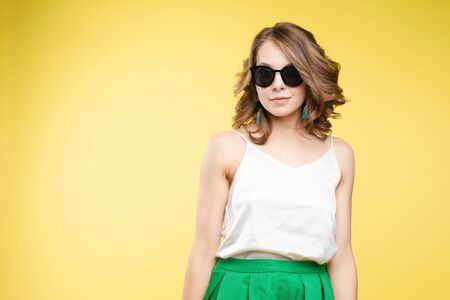 Fashionable young woman in sunglasses. Studio portrait of beautiful caucasian Reklamní fotografie