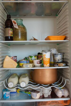 Belarus Minsk 06 12 2019 Front view of refrigerator full of food staying at home