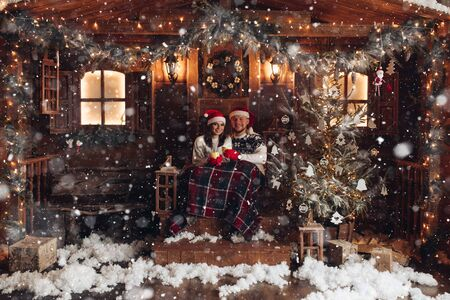 Christmas romance in Santa Claus hats beautiful house New Years atmosphere