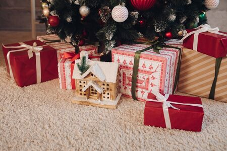 Beautiful wrapped Christmas presents under the tree. Stock Photo
