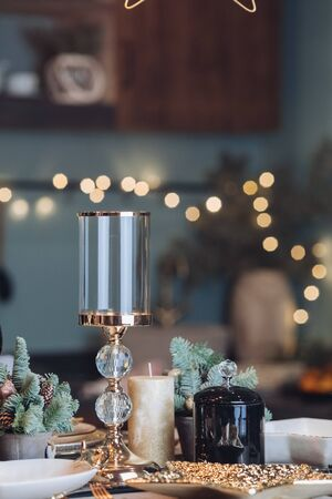 Glass candlestick on a New Year table