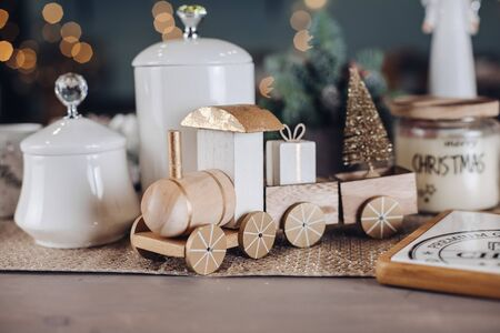Toy wooden locomotive with New Year gifts