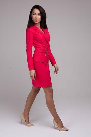 Elegant woman in red dress and beige heels. Stok Fotoğraf