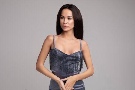 Gorgeous model in grey party dress. Studio shot. Stok Fotoğraf