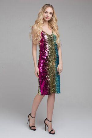 Smiling brunette lady in shiny fashion dress