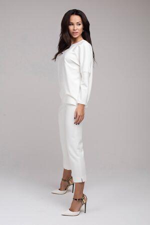 Happy elegant fashionable woman looking at camera