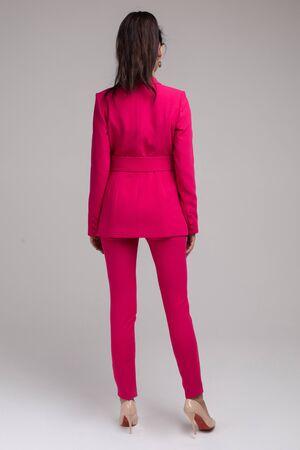 Stunning brunette woman in bright red jacket. Stok Fotoğraf