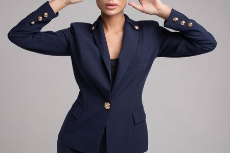 Attractive elegant woman in black office suit and heels.
