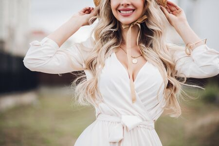 Immaculate lady in white dress and hat.