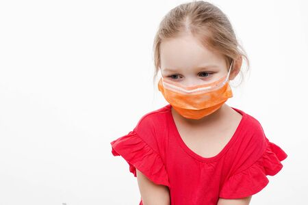 Lovely kid in medical protective mask. Stop viruses concept.